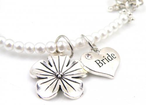 Closeup of Bride charm and flower